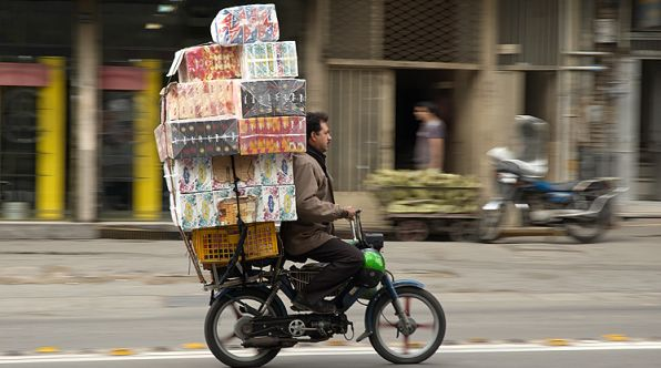 Man delivering goods on motorbike