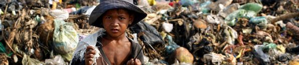 Child on a rubbish dump